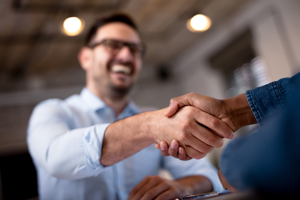 Businessmen in a handshake agreement in an office
